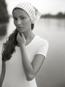 black and white location portrait of Loly wearing white dress and bandana