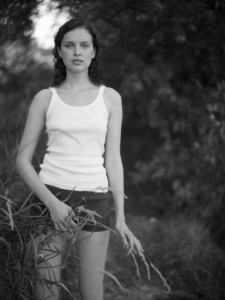 black and white portrait of Tatyana on forest pathway