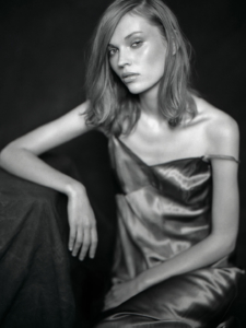black and white studio portrait of Julia wearing silk lingerie