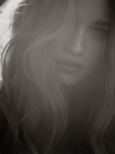 black and white backlit studio portrait of Lesly