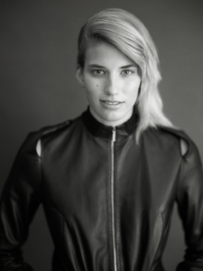 black and white studio portrait of Verronika wearing black leather jacket