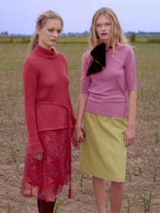 colour portrait of Alissa and her sister holding hands standing in farm field