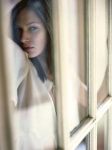 colour portrait of Grace behind glass door