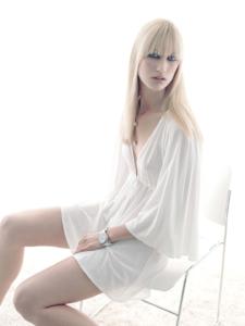 colour studio high-key portrait for Grazia magazine Italy of Lizette in a white dress