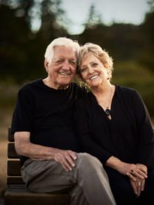 colour last light portrait of Bert and Loretta sitting on park bench Victoria BC